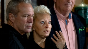 Charlotte Charles, mother of Harry Dunn, who died after his motorbike was involved in an August 2019 accident in Britain with Anne Sacoolas, wife of an American diplomat, speaks at a news conference as she is joined by husband Bruce Charles, left, stepfather of Dunn, Monday, Oct. 14, 2019, in New York. (AP Photo/Craig Ruttle)