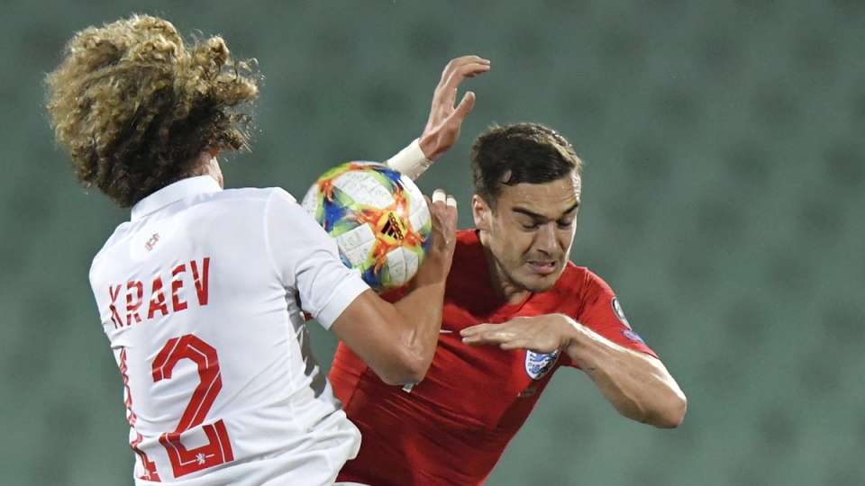 Bulgaria's Bozhidar Kraev, left, fights for the ball with England's Harry Winks during the Euro 2020 group A qualifying soccer, in Sofia, Bulgaria, on Oct. 14, 2019. (Andreea Alexandru / AP)