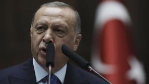 Turkish President Recep Tayyip Erdogan addresses his ruling party legislators at the Parliament, in Ankara, on Oct 16, 2019. (Burhan Ozbilici / AP)