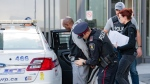 A suspect is seen being arrested by police in Toronto as part of Project Convalesce. (York Regional Police)