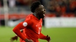 Canada midfielder Alphonso Davies (12) celebrates a goal against the United States during second half of CONCACAF Nations League soccer action in Toronto, Tuesday, Oct. 15, 2019. THE CANADIAN PRESS/Cole Burston
