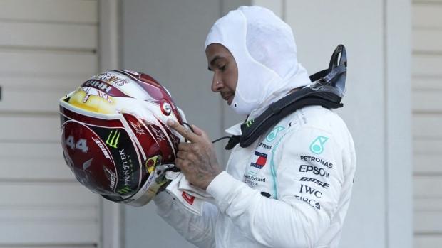 Mercedes driver Lewis Hamilton takes off his helmet after the Japanese Formula One Grand Prix at Suzuka Circuit, on Oct. 13, 2019. (Toru Hanai / AP)