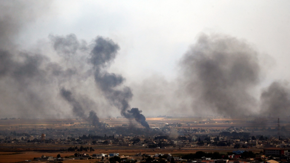 In this photo taken from the Turkish side of the border between Turkey and Syria, in Ceylanpinar, Sanliurfa province, southeastern Turkey, smoke billows from targets in Ras al-Ayn, Syria, during bombardment by Turkish forces, Wednesday, Oct. 16, 2019. (AP Photo/Lefteris Pitarakis)