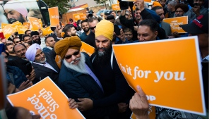 NDP leader Jagmeet Singh, centre, greets supporters during a campaign stop in Brampton, Ont., on Saturday, October 12, 2019. THE CANADIAN PRESS/Nathan Denette