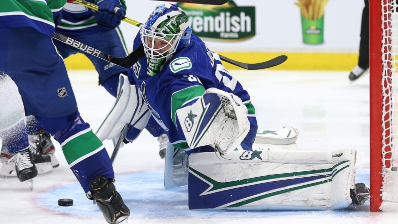 Vancouver Canucks goalie Thatcher Demko (35) makes a save during third period NHL hockey action against the Detroit Red Wings, in Vancouver on Tuesday, Oct. 15, 2019. (Ben Nelms / THE CANADIAN PRESS)