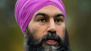NDP leader Jagmeet Singh speaks to the media at Jack Layton Park during a campaign stop in Hudson, Que., on Wednesday, October 16, 2019. THE CANADIAN PRESS/Nathan Denette