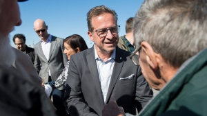 Bloc Quebecois leader Yves-Francois Blanchet greets supporters during a federal election campaign stop in Lachute, Que., Friday, October 11, 2019. THE CANADIAN PRESS IMAGES/Graham Hughes