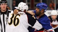 New York Rangers' Donald Brashear (87) fights Atlanta Thrashers' Eric Boulton (36) during the first period of an NHL hockey game Thursday, Nov. 12, 2009, in New York. (AP Photo/Frank Franklin II)