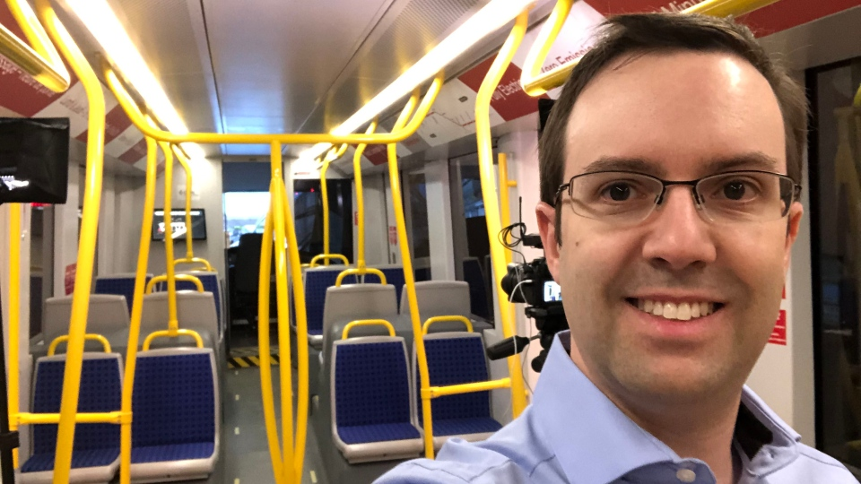 O-Train fans website creator Shane Seguin rides one of the new Alstom-Citadis-Spirit trains
