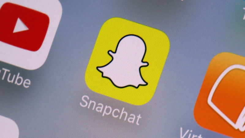 This Aug. 9, 2017, file photo shows the Snapchat app on a mobile device in New York. (AP Photo/Richard Drew, File)