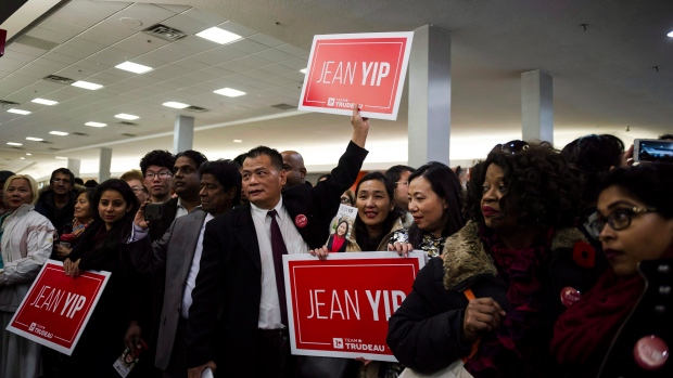 A crowd waits for the arrival of Justin Trudeau and Liberal candidate Jean Yip, in Toronto on Wednesday, November 22, 2017. CTV News obtained screenshots of two political ads pushed to users on Chinese social media app WeChat, both approved by Yip's campaign but were not paid for. (The Canadian Press/Christopher Katsarov)