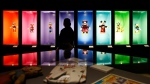 "A visitor walks past a display of Disney characters inside an exhibition entitled ""Mexico and Walt Disney: A Magical Encounter,"" at the Cineteca Nacional, Mexico's film archive, in Mexico City, Nov. 16, 2017. THE CANADIAN PRESS/AP-Rebecca Blackwell"