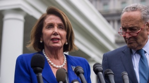 U.S. House Speaker Nancy Pelosi of Calif., left, and Senate Minority Leader Chuck Schumer of N.Y., speak with reporters after a meeting with U.S. President Donald Trump at the White House, Wednesday, Oct. 16, 2019, in Washington. (AP Photo/Alex Brandon)