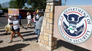 This June 2018 file photo shows protesters walking along Montana Avenue outside the El Paso Processing Center in El Paso, Texas. (Rudy Gutierrez/The El Paso Times via AP, File)