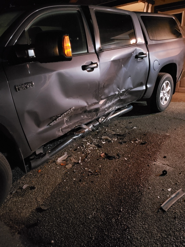 The damage to one parked truck is shown after a stolen vehicle collided with it. (Roger Harper)