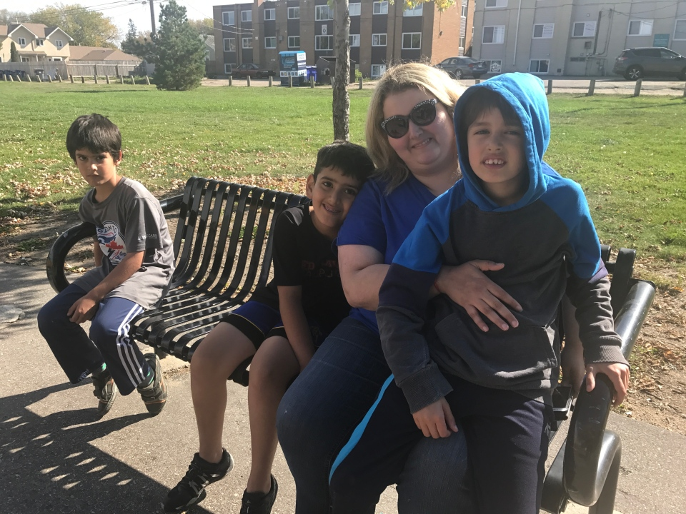 Alia Raja siting with her children in Pleasant Hill.