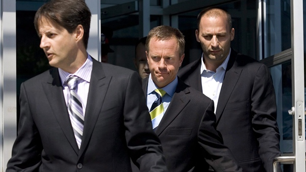 Former Ontario attorney general Michael Bryant (centre) is flanked by his lawyers as he leaves Toronto police Traffic Services headquarters in Liberty Village in Toronto, Tuesday, Sept. 1, 2009. (Darren Calabrese / THE CANADIAN PRESS)