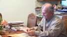 A Lethbridge retiree is protesting a government ruling to delay paying him his pension.