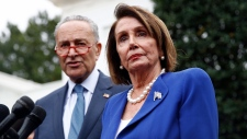 House Speaker Nancy Pelosi of Calif., right, speaks with members of the media alongside Senate Minority Leader Sen. Chuck Schumer of N.Y., outside of the West Wing of the White House after a meeting with President Donald Trump, Wednesday, Oct. 16, 2019, in Washington. (AP / Patrick Semansky)