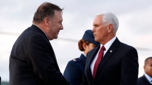 Vice President Mike Pence and Secretary of State Mike Pompeo shake hands as they arrive at Andrews Air Force Base, Md., Wednesday, Oct. 16, 2019, to depart en route to Turkey. (AP Photo/Jacquelyn Martin)