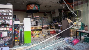 Debris are scattered on the floor of a damaged store a day after a strong quake struck in Digos, Davao del Sur province, southern Philippines Thursday, Oct. 17, 2019. (AP Photo)