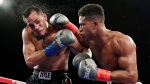 FILE - In this Oct. 27, 2018, file photo, Patrick Day, right, punches Elvin Ayala during the fifth round of a WBC super welterweight boxing bout in New York. (AP Photo/Frank Franklin II, File)