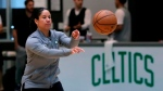 FILE - In this July 1, 2019, file photo, Boston Celtics assistant coach Kara Lawson passes the ball at the team's training facility in Boston. (AP Photo/Charles Krupa, File)