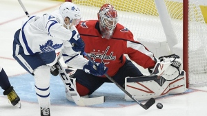 Toronto Maple Leafs right wing Ilya Mikheyev (65), of Russia, tries to get the puck past Washington Capitals goaltender Ilya Samsonov, of Russia, during the third period of an NHL hockey game Wednesday, Oct. 16, 2019, in Washington. The Capitals won 4-3. (Nick Wass/AP Photo)