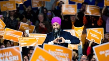 NDP leader Jagmeet Singh reacts to supporters at a rally during a campaign stop in Montreal, Que., on Wednesday, October 16, 2019. THE CANADIAN PRESS/Nathan Denette