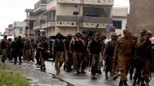 Pakistan army soldiers leave after the crackdown operation against terrorists in Peshawar, Pakistan, Tuesday, April 16, 2019. (AP Photo/Muhammad Sajjad)