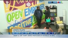 The Travelling Sign Painters' Joseph Pilapil is working with students on completing a mural. Rachel Lagacé reports on the benefits of the collaboration.