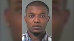 Police are looking for 25-year-old Olivier Tumba, who is facing charges of attempted murder and aggravated assault in connection with a shooting outside a strip club in Dieppe, N.B. (New Brunswick RCMP)