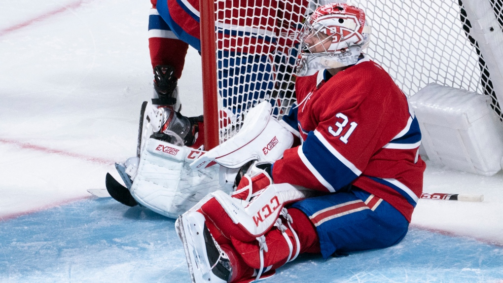 Carey Price makes a save against Tampa Bay