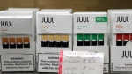In this Thursday, Dec. 20, 2018 file photo, Juul products are displayed at a smoke shop in New York. On Thursday, Oct. 17, 2019, the company announced it will voluntarily stop selling its fruit and dessert-flavored vaping pods. (AP Photo/Seth Wenig)