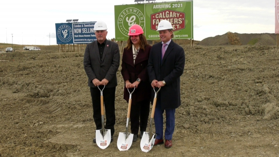 Ward 1 councillor Ward Sutherland, Calgary Farmers' Market's Stacey Petropoulos and Melcor's Darin Rayburn turn the soil at the northwest Calgary Farmers' Market on October 17, 2019
