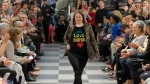 """This image from video taken on Wednesday, Oct. 16, 2019 shows a girl participating in the 2nd annual """"Gigi's Playhouse Fashion Show"""" in New York. Gigi's Playhouse is an education and achievement center that prepares young people with Down syndrome to engage more fully in their homes, schools and communities. (AP Photo/Gary Gerard Hamilton)"""