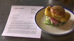 The burger formerly known as the 'Effing Filet O' Fish' is shown next to the cease-and-desist letter that prompted its name change. Oct. 17, 2019. (CTV News Edmonton)