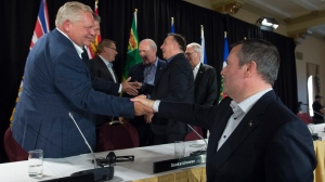 Alberta Premier Jason Kenney shakes hands with Ontario Premier Doug Ford following a closing news conference at a meeting of Canada's Premiers in Saskatoon, Sask. Thursday, July 11, 2019. (THE CANADIAN PRESS / Jonathan Hayward)