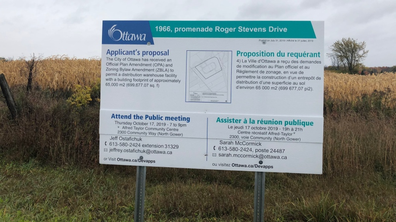 An Applicant's proposal sign on the south side of Roger Stevens Drive near Highway 416 indicates where a 700-thousand square-foot distribution warehouse facility could be built.