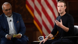 Facebook CEO Mark Zuckerberg speaks at Georgetown University, Thursday, Oct. 17, 2019, in Washington. At left is Mo Elleithee, the founding Executive Director of Georgetown University's Institute of Politics and Public Service. (AP Photo/Nick Wass)
