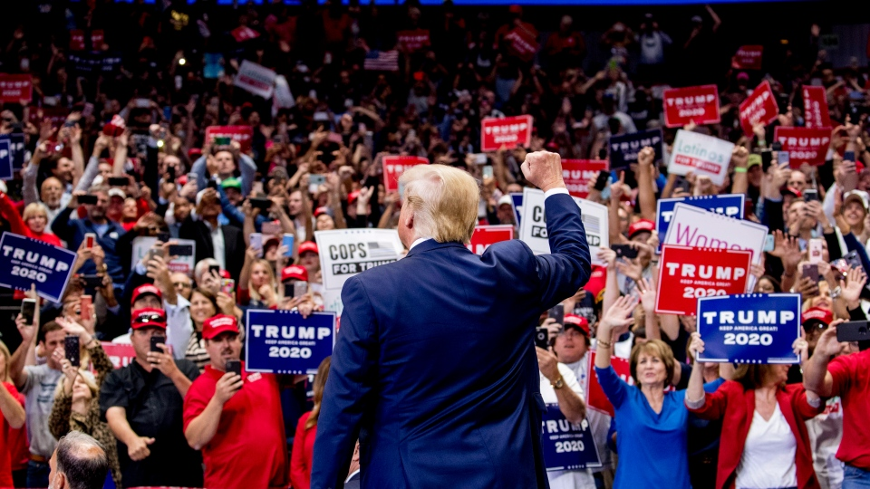 U.S. President Donald Trump takes the stage at a campaign rally at American Airlines Arena in Dallas, Texas, Thursday, Oct. 17, 2019. (AP Photo/Andrew Harnik)