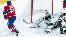 Montreal Canadiens' Nick Suzuki scores past Minnesota Wild goaltender Alex Stalock during first period NHL hockey action in Montreal on Thursday, October 17, 2019. THE CANADIAN PRESS/Paul Chiasson