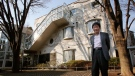 """FILE - In this Feb. 12, 2015 file photo, co-founder of Japan's prestigious Studio Ghibli, Isao Takahata, stands in front of his office at Studio Ghibli in suburban Tokyo after an interview about his animated film """"The Tale of The Princess Kaguya."""" (AP Photo/Shizuo Kambayashi, File)"""