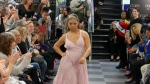 """This image from video taken on Wednesday, Oct. 16, 2019 shows Laura Lyle participating in the 2nd annual """"Gigi's Playhouse Fashion Show"""" in New York. (AP Photo/Gary Gerard Hamilton)"""