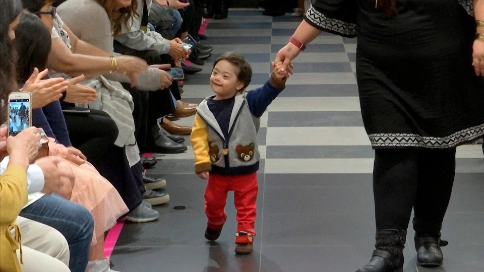 """This image from video taken on Wednesday, Oct. 16, 2019 shows a young boy participating in the 2nd annual """"Gigi's Playhouse Fashion Show"""" in New York. (AP Photo/Gary Gerard Hamilton)"""
