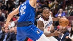Los Angeles Clippers' Kawhi Leonard (2) drives against Dallas Mavericks' Maxi Kleber (42), of Germany, during first half pre-season NBA basketball action in Vancouver on Thursday October 17, 2019. THE CANADIAN PRESS/Darryl Dyck