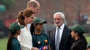 Britain's Prince William and his wife Kate, Duchess of Cambridge, meet Ehsan Mani, Chairman of the Pakistan Cricket Board and students during their visit at the Pakistan Cricket Academy in Lahore, Pakistan, Thursday, Oct. 17, 2019. (AP Photo/B.K. Bangash)