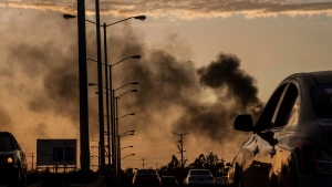 Smoke from burning cars rises amid a gunfight in Culiacan, Mexico, Thursday, Oct. 17, 2019. (AP Photo/Augusto Zurita)