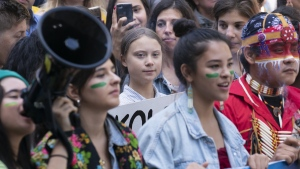 Swedish activist and student Greta Thunberg, centre, takes part in the Climate Strike, in Montreal on Sept. 27, 2019. (Paul Chiasson / THE CANADIAN PRESS)