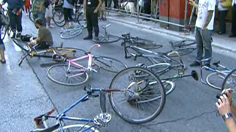 Hundreds of cyclists gather at a protest in honour of Darcy Allen Sheppard on Bloor Street, Wednesday, Sept. 2, 2009.